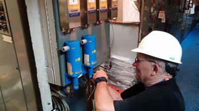 Al Yessel Aboard Vessel Installing TLI System